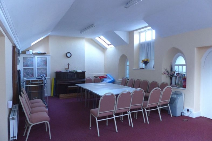 Meeting room set out with a centre table surrounded by chairs